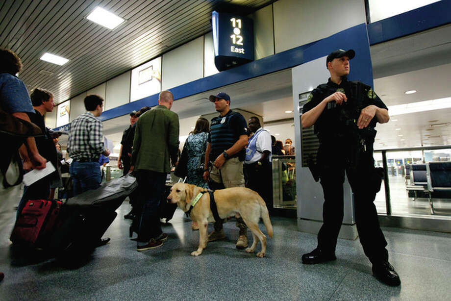 Amtrack police officers stand guard while commuters get ready to board their train in New York Pennsylvania Station on Friday, Sept. 9, 2011 in New York. The city is deploying additional resources and taking other security steps in response to a potential terror threat before the 10th anniversary of the Sept. 11 attacks. U.S. counterterrorism officials are chasing a credible but unconfirmed al-Qaida threat to use a car bomb on bridges or tunnels in New York or Washington. (AP Photo/Jin Lee) / FR159730 AP