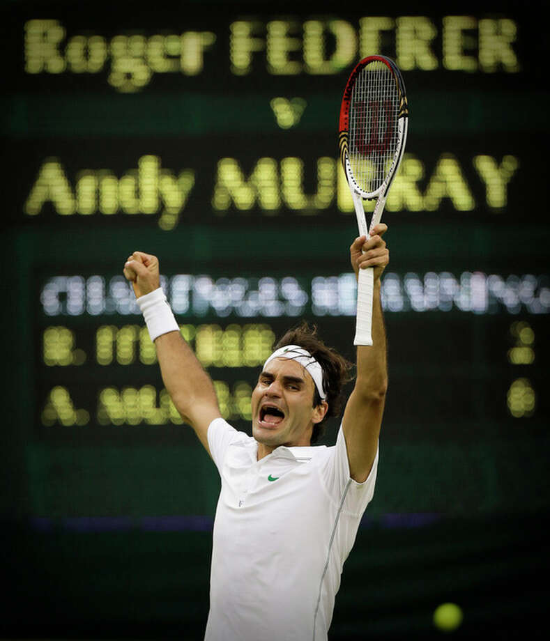 Roger Federer of Switzerland celebrates winning the men's singles final against Andy Murray of Britain at the All England Lawn Tennis Championships at Wimbledon, England, Sunday, July 8, 2012. (AP Photo/Anja Niedringhaus) / AP