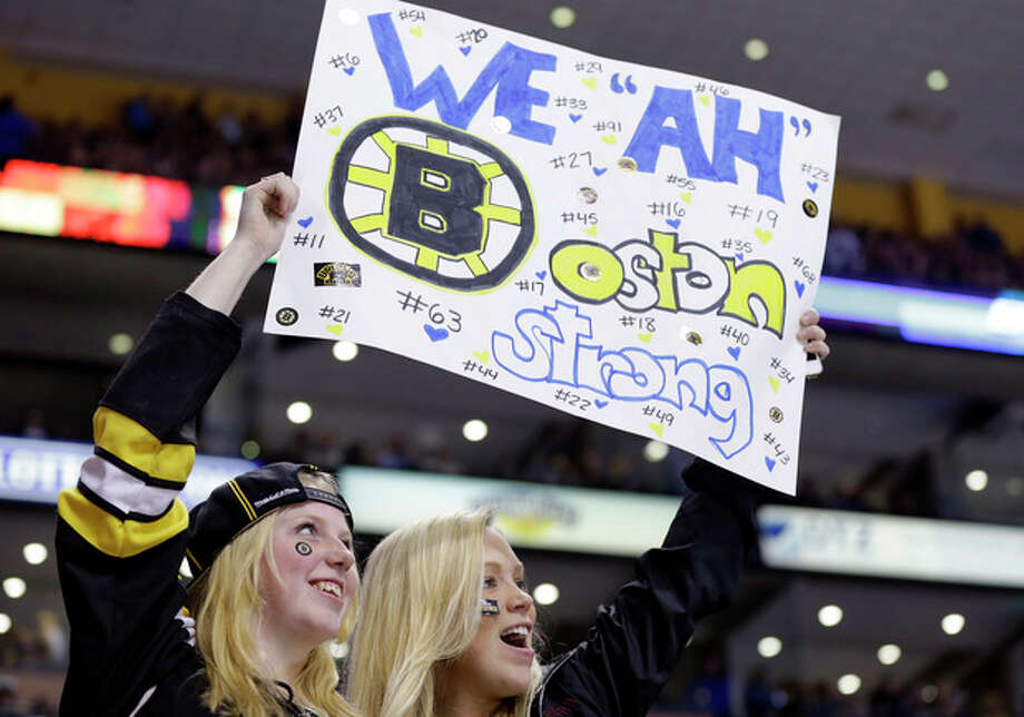 Fans hold up a sign during the second period of an NHL hockey game between the Boston Bruins and the Buffalo Sabres in Boston Wednesday, April 17, 2013. (AP Photo/Elise Amendola) / AP