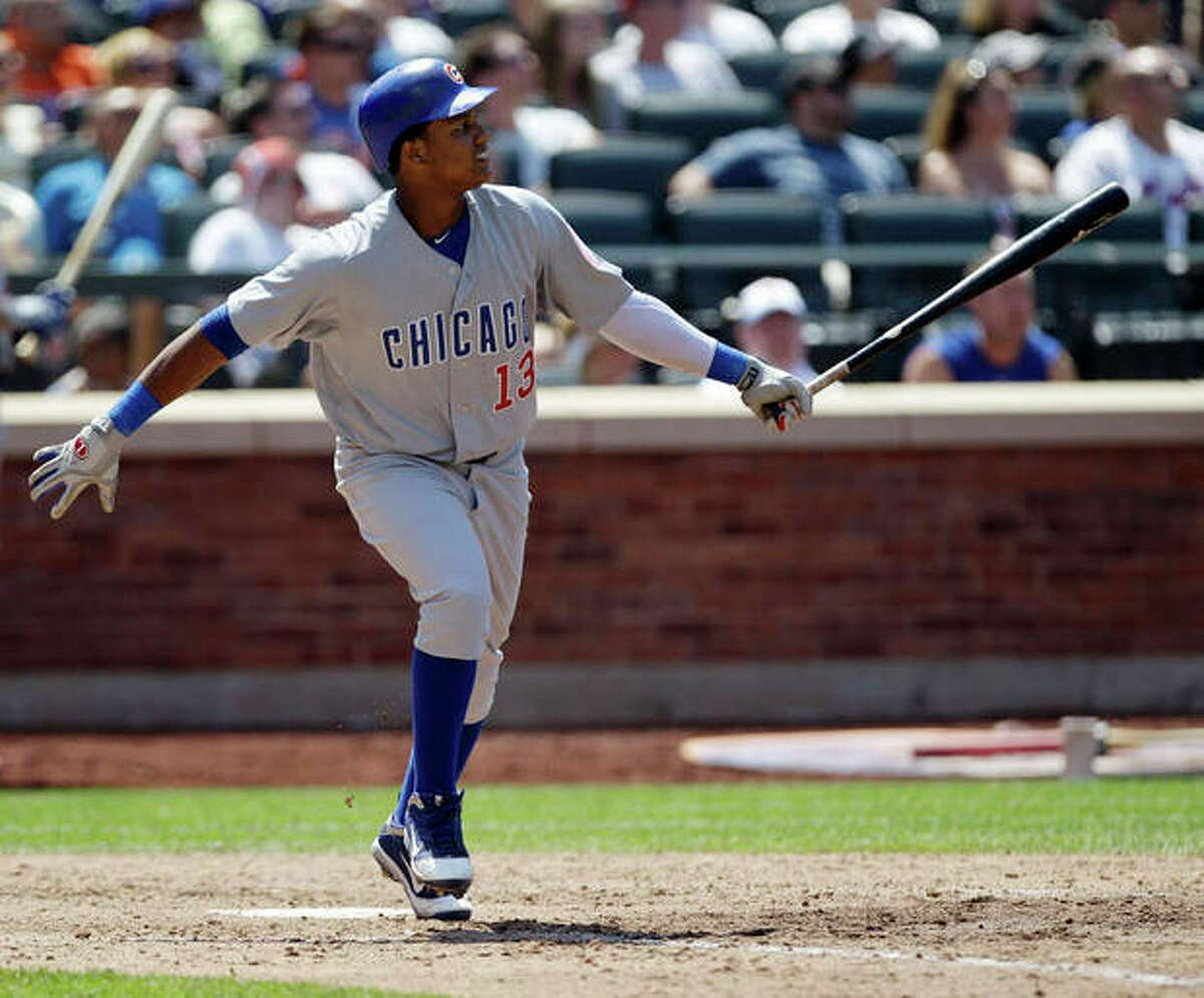 Chicago Cubs' Starlin Castro follows through on a seventh-inning three-run home run off New York Mets starting pitcher Jonathon Niese during their baseball game at Citi Field in New York, Sunday, July 8, 2012. (AP Photo/Kathy Willens)