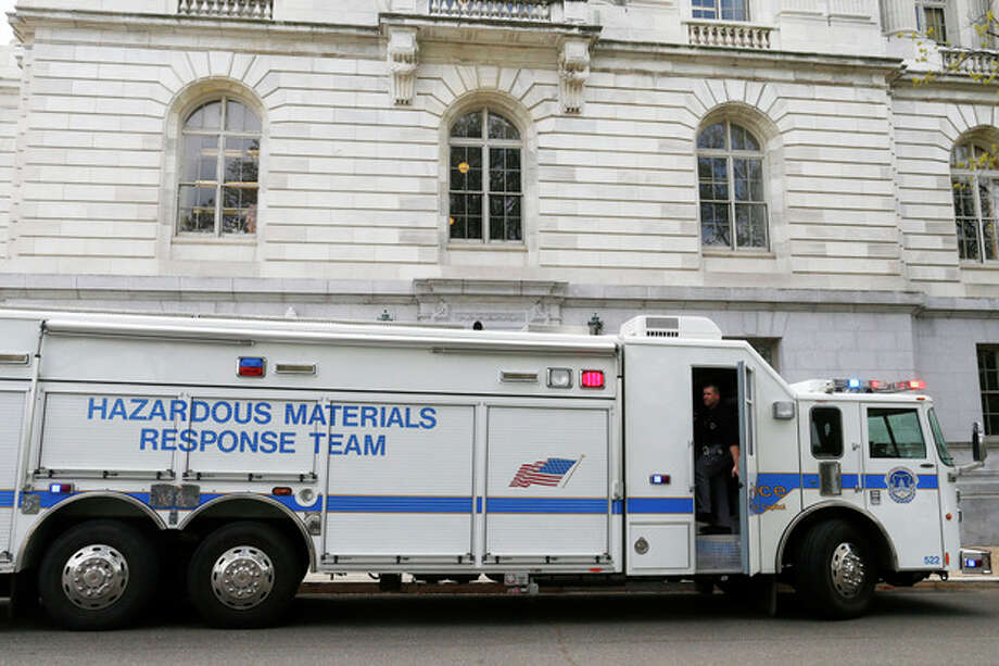 A Capitol Police Hazardous Materials Response Team truck is parked at the Russell Senate Office building on Capitol Hill in Washington, Wednesday, April 17, 2013, after reports of suspicious packages discovered on Capitol Hill. U.S. Capitol police are investigating the discovery of at least two suspicious envelopes in Senate office buildings across the street from the Capitol. (AP Photo/Charles Dharapak) / AP