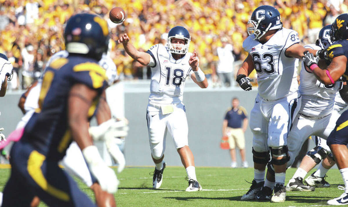 Connecticut quaterback Johnny McEntee (18) makes a throw during the first half of their NCAA college football game at No. 16 West Virginia on Saturday, Oct. 8, 2011, in Morgantown, W.Va. (AP Photo/Chris Jackson)