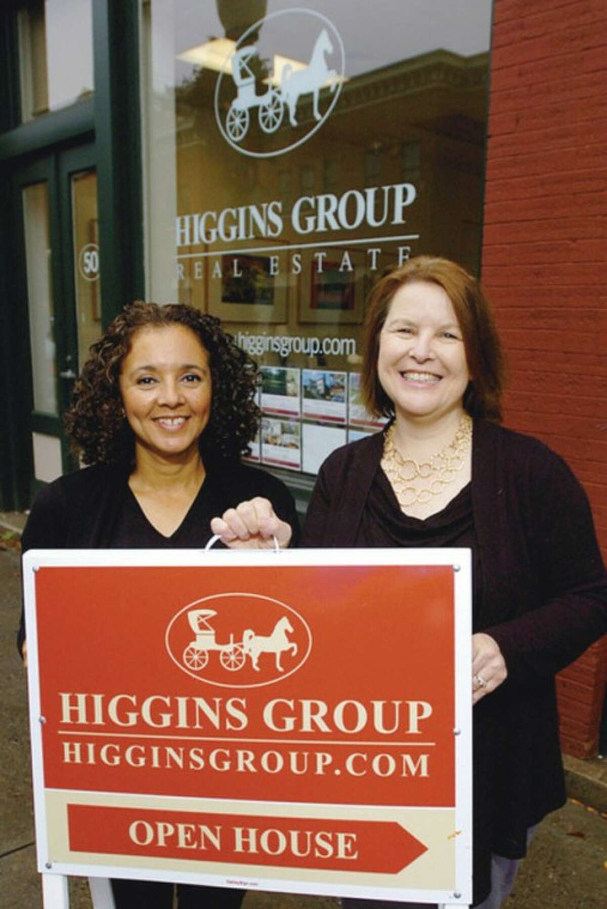 Realtors with Higgins Group Real Estate, Monica Osorio and Natlaie Mazola at their offices on Water St in Norwalk. The Higgins Group is holding real estate open house forum on Thursday. Hour photo / Erik Trautmann
