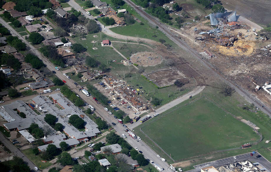 This Thursday, April 18, 2013 aerial photo shows the remains of a nursing home, left, apartment complex, center, and fertilizer plant, right, destroyed by an explosion in West, Texas. Rescuers searched the smoking remnants for survivors of Wednesday night's thunderous fertilizer plant explosion, gingerly checking smashed houses and apartments for anyone still trapped in debris while the community awaited word on the number of dead. Initial reports put the fatalities as high as 15, but later in the day, authorities backed away from any estimate and refused to elaborate. More than 160 people were hurt. (AP Photo/Tony Gutierrez) / AP