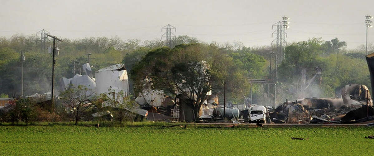 Mangled debris of a fertilizer plant are seen Thursday, April 18, 2013, a day after an explosion leveled the plant in West, Texas. The massive explosion at the West Fertilizer Co. Wednesday night killed as many as 15 people and injured more than 160. (AP Photo/The Times, Henrietta Wildsmith)