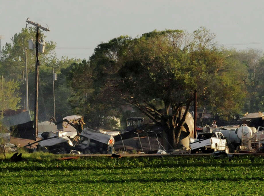 Mangled debris of a fertilizer plant are seen Thursday, April 18, 2013, a day after an explosion leveled the plant in West, Texas. The massive explosion at the West Fertilizer Co. Wednesday night killed as many as 15 people and injured more than 160. (AP Photo/The Times, Henrietta Wildsmith) / Shreveport Times