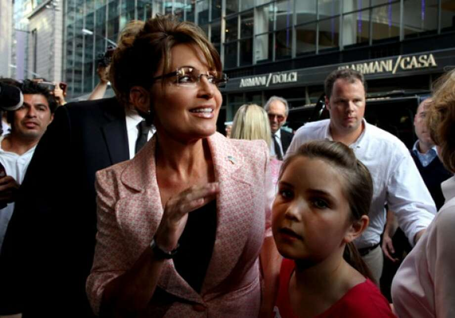 Former governor of Alaska Sarah Palin walks to the door of Trump Tower for a scheduled meeting with Donald Trump in New York, Tuesday, May 31, 2011. (AP Photo/Craig Ruttle)