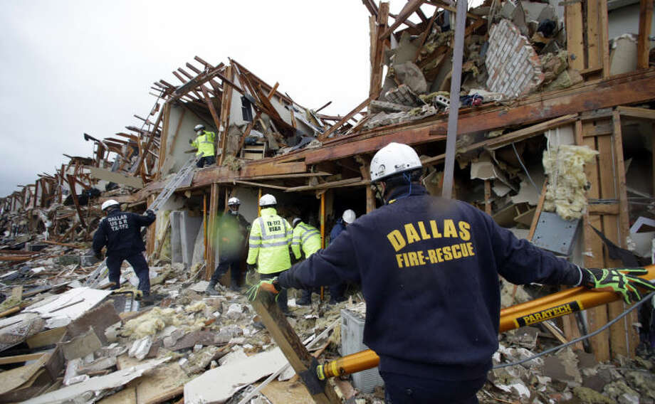 FILE - In this Thursday, April 18, 2013 file photo, emergency personnel search the rubble of an apartment destroyed by an explosion at a fertilizer plant in West, Texas. Event after nail-biting event, America was rocked this week, in rare and frightening ways, with what felt like an unremitting series of tragedies. (AP Photo/LM Otero, File)