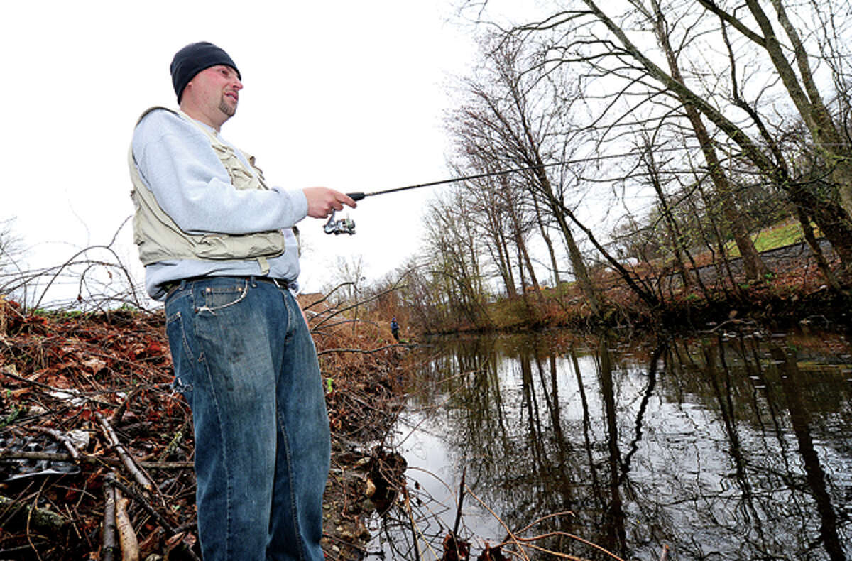 Nick Botelho fishes for trout on the Norwalk River in Wilton during opening day Saturday. Hour photo / Erik Trautmann