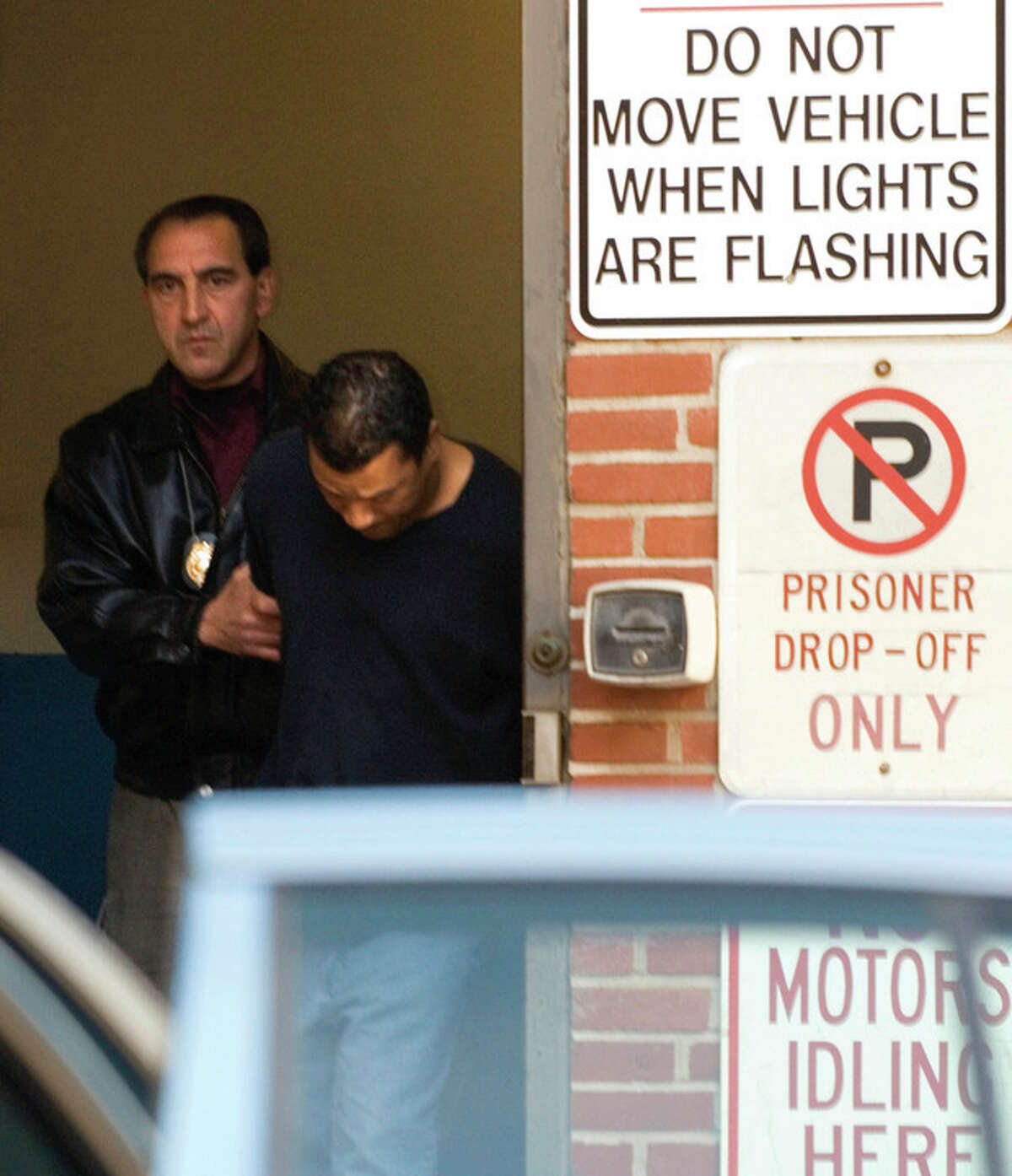 Stamford Police Lt. John Forlivio, left, escorts Harry Gonzalez 38, to an arraignment, Monday, Oct. 31, 2005 in Stamford Conn., in connection with the Oct. 6 murder of Joanne Trautwein, 75, of Stamford. Gonzalez and his girlfriend, Jennifer Kos, 28, were arrested Friday at a Burger King in Shelton, Conn. They were charged with felony murder and are each being held on $2 million bond. (AP Photo/Douglas Healey)