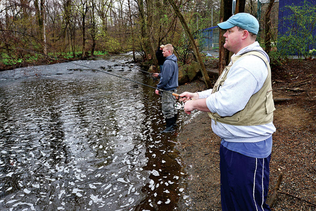 Paul Paris of Satmford fishes for trout on the Norwalk River in Wilton during opening day Saturday. Hour photo / Erik Trautmann