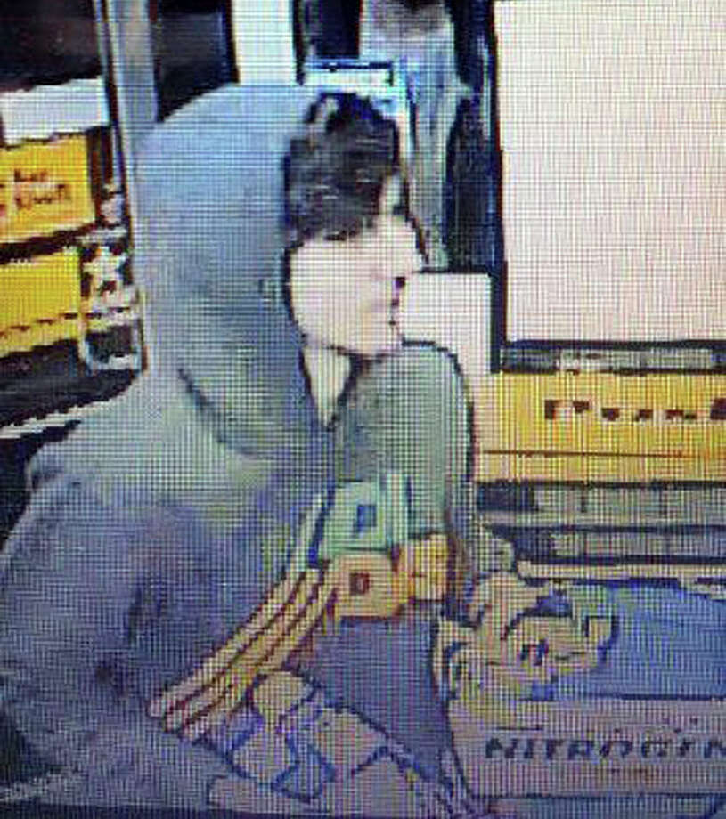 This surveillance photo released via Twitter Friday, April 19, 2013 by the Boston Police Department shows a suspect entering a convenience store that police are pursuing in Watertown, Mass. Police say he is one of two suspects in the fatal shooting of an MIT police officer and tied to the Boston Marathon bombing. (AP Photo/Boston Police Department) / Boston Police Department