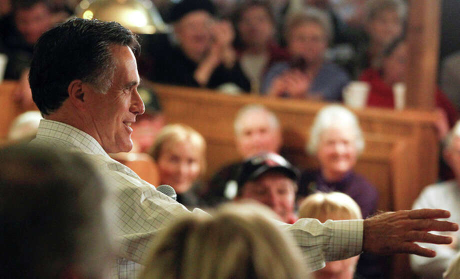 Republican presidential candidate, former Massachusetts Gov. Mitt Romney speaks during a campaign stop at Homer's Deli and Bakery in Clinton, Iowa, Wednesday, Dec. 28, 2011. (AP Photo/Chris Carlson) / AP