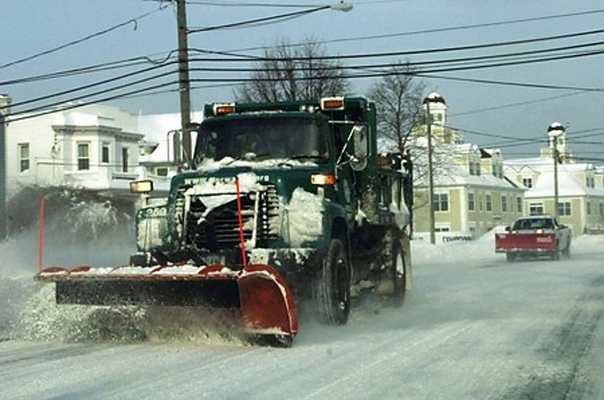 A Norwalk city plow takes snow off East Ave. Hour photo / Erik Trautmann