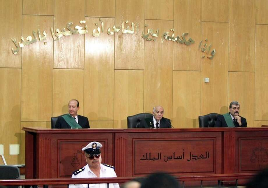 Judges participate in the trial of Alaa and Gamal Mubarak, sons of outsted President Hosni Mubarak, on charges of insider trading, in a courtroom in Cairo, Egypt, Monday, July 9, 2012. The sons of ousted Egyptian leader Hosni Mubarak, one-time heir apparent Gamal and wealthy businessman Alaa, went on Trial on Monday charged with insider trading. The trial was adjoruned until Sept. 8 to allow defense lawyers to familiarize themselves with the case. The court also denied a request by the defense for the release on bail of the Mubarak sons. (AP Photo/Ahmed Gomaa) / AP