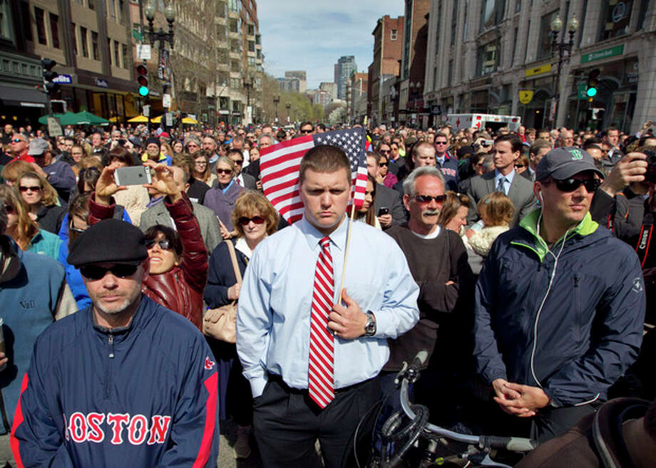 A moment of silence in honor of the victims of the Boston Marathon bombing is observed on Boylston Street near the race finish line, exactly one week after the tragedy, Monday, April 22, 2013, in Boston, Mass. (AP Photo/Robert F. Bukaty) / AP