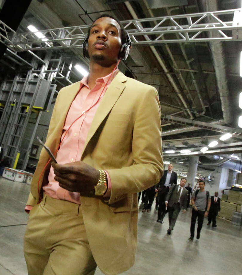 Milwaukee Bucks point guard Brandon Jennings arrives at AmericanAirlines Arena for Game 1 of their first-round NBA basketball playoff series against the Miami Heat in Miami, Sunday, April 21, 2013. (AP Photo/Alan Diaz) / AP