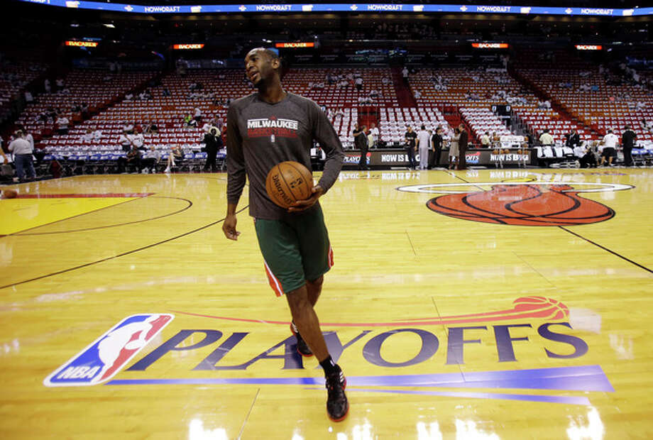 Milwaukee Bucks power forward Luc Richard Mbah a Moute practices before Game 1 of their first-round NBA basketball playoff series against the Miami Heat in Miami, Sunday, April 21, 2013. (AP Photo/Alan Diaz) / AP