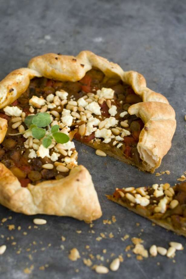 This Nov. 21, 2011 photo shows Mediterranean vegetable tart in Concord, N.H. This easy vegetarian tart is perfect for a holiday celebration. (AP Photo/Matthew Mead)