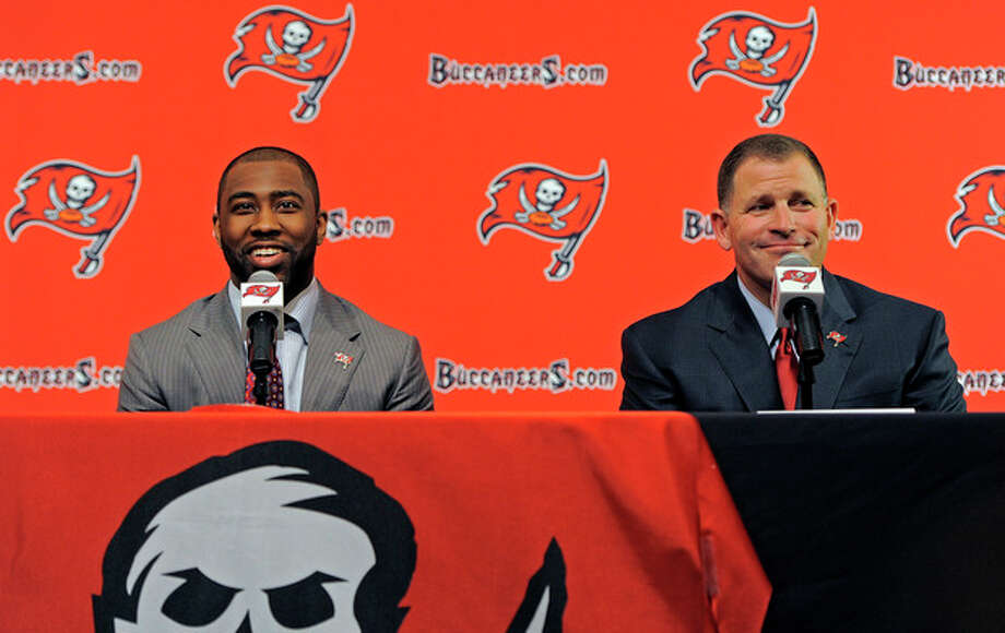 NFL cornerback Darrelle Revis, left, and head coach Greg Schiano address the media while announcing that the Buccaneers have acquired Revis from the New York Jets during an NFL football press conference Monday, April, 22, 2013, in Tampa, Fla. The Buccaneers and Revis have agreed on a six-year contract. (AP Photo/Brian Blanco) / FR170107 AP
