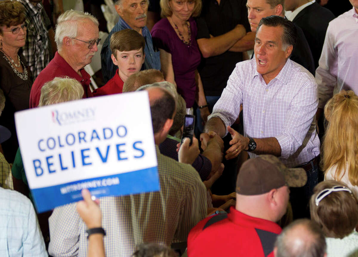 Republican presidential candidate, former Massachusetts Gov. Mitt Romney shakes hands during a campaign stop at Central High School, Tuesday, July 10, 2012, in Grand Junction, Colo. (AP Photo/Evan Vucci)