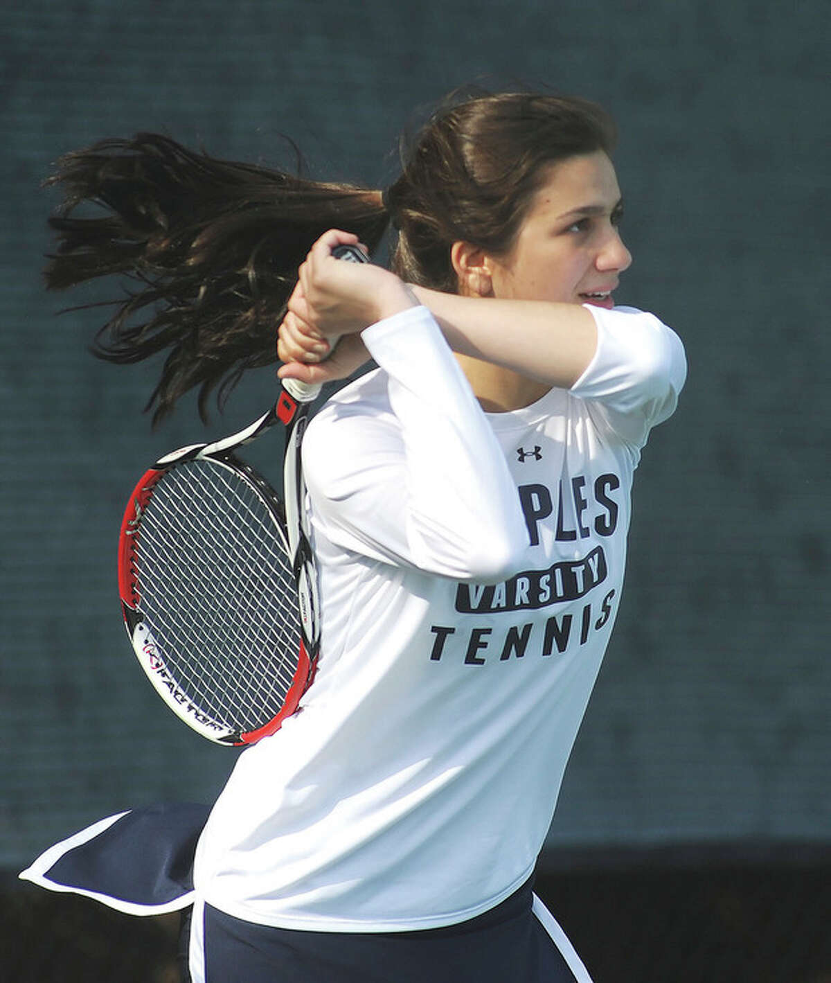 Hour photo/John Nash Melissa Beretta, the No. 1 singles player from Staples, laces a back-hand return during her team's win over Danbury on Monday afternoon.