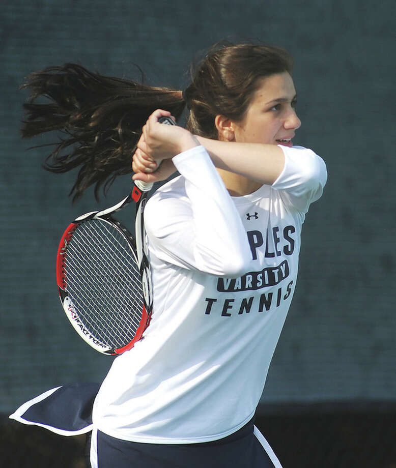 Hour photo/John NashMelissa Beretta, the No. 1 singles player from Staples, laces a back-hand return during her team's win over Danbury on Monday afternoon.