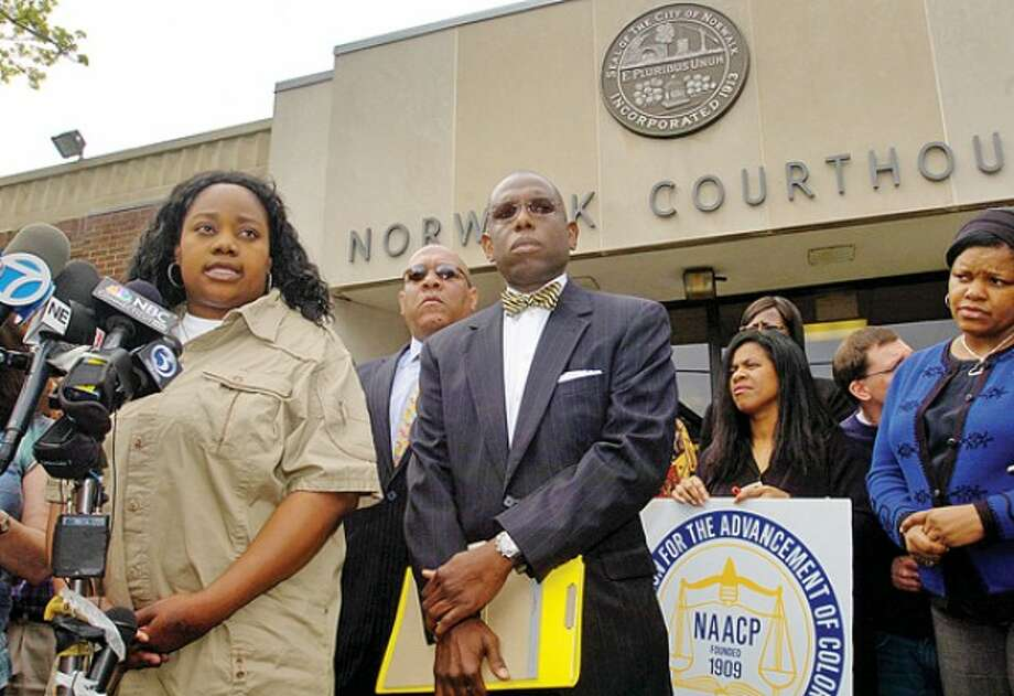 Tanya McDowell, who was arrested and charged with larceny and conspiracy to commit larceny for allegedly stealing $15,686 from Norwalk schools after she enrolled her son in the school system, comments with her attorney Darnell Crosdale during a press conference outside Norwalk Superior Court Wednesday morning. Hour photo / Erik Trautmann