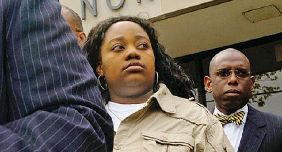 Tanya McDowell, who was arrested and charged with larceny and conspiracy to commit larceny for allegedly stealing $15,686 from Norwalk schools after she enrolled her son the Norwalk Public Schools, attends a press conference outside Norwalk Superior Court Wednesday morning. Hour photo / Erik Trautmann