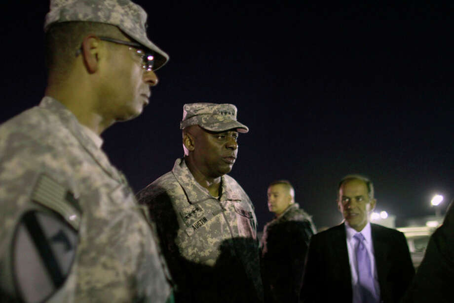 Gen. Lloys Austin, the top US commander for Iraq, center, looks on during a visit to the Khabari Crossing to welcome the last convoy of the US Army's 3rd Brigade, 1st Cavalry Division after they crossed the border from Iraq into Kuwait, Sunday, Dec. 18, 2011. The brigade's special troops battalion are the last American soldiers to leave Iraq. The U.S. military announced Saturday night that the last American troops have left Iraq as the nearly nine-year war ends. (AP Photo/Maya Alleruzzo) / AP