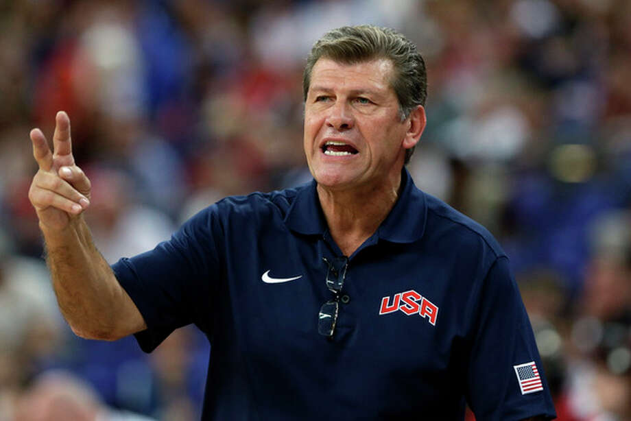 FILE - In this April 11, 2012 file photo, United States coach Geno Auriemma talks to his players during a women's gold medal basketball game against France at the 2012 Summer Olympics in London. A New York City judge has dismissed a discrimination and assault lawsuit against University of Connecticut women's basketball coach Auriemma and USA Basketball. NBA security official Kelley Hardwick had sued in June. She alleged she was removed from the USA women's basketball team's security detail at the London Olympics last year after spurning sexual advances from Auriemma. (AP Photo/Eric Gay, File) / AP