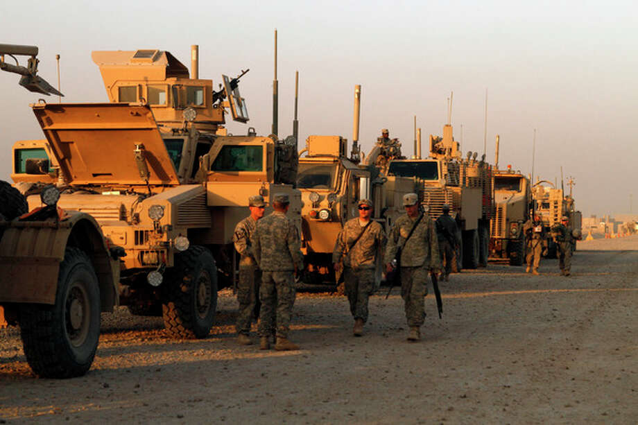 In this Saturday, Dec. 17, 2011 photo, U.S. Army soldiers from 3rd Brigade, 1st Cavalry Division, based at Fort Hood, Texas, stage their armored vehicles at Camp Adder during final preparations for the last American convoy to leave Iraq. The U.S. military says the last American troops have left Iraq as the nearly nine-year war ends. (AP Photo/Maya Alleruzzo) / AP