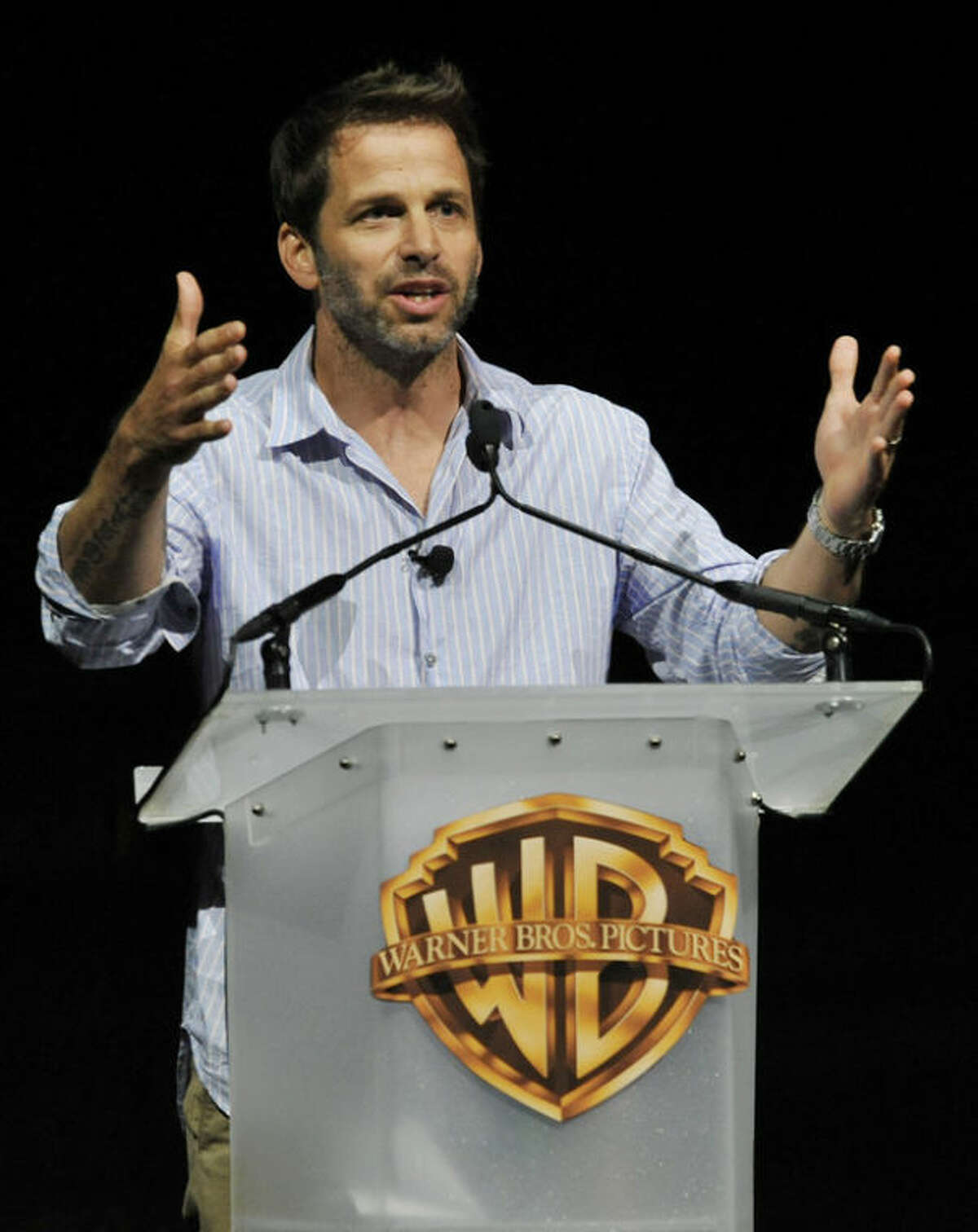 """Zack Snyder, director of the forthcoming film """"Man of Steel,"""" addresses the audience during the Warner Bros. presentation at CinemaCon 2013 at Caesars Palace on Tuesday, April 16, 2013 in Las Vegas. (Photo by Chris Pizzello/Invision/AP)"""