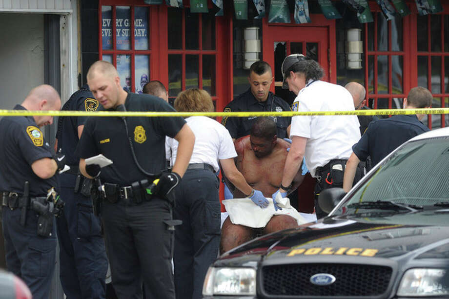 Police and EMT respond to Van Zant Street in Norwalk Monday at about 3:30 after a call came in that a man was stabbed. Hour photo / Matthew Vinci / (C)2011, The Hour Newspapers, all rights reserved