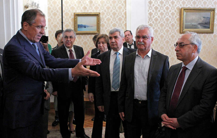 Russian Foreign Minister Sergey Lavrov, left, welcomes a delegation headed by a leader of the Syrian National Council (SNC), Abdulbaset Sieda, right, in Moscow, Russia, Wednesday, July 11, 2012. (AP Photo/Misha Japaridze) / AP