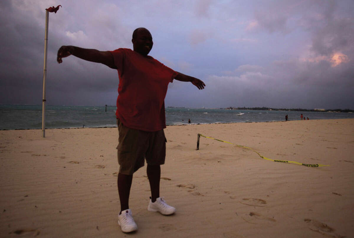 Kenny Mondesir of Nassau stands against the force of wind felt from the effects of Hurricane Irene in Nassau, on New Providence Island in the Bahamas, Wednesday, Aug. 24, 2011. Hubert Ingraham, the prime minister of the Bahamas said Hurricane Irene has caused isolated damage on its march up the island chain but so far no deaths or injuries. (AP Photo/Lynne Sladky)