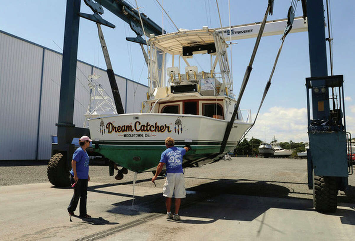 Crew at Sunset Marina in West Ocean City, Md., lift a boat from the water on Wednesday, Aug. 24, 2011 as Hurricane Irene strengthened to a Category 3 storm over the Bahamas. FEMA warned that residents of the East Coast as far north as Maine should be prepared, with coastal flooding and high winds that may cause power outages. (AP Photo/Salisbury Daily Times, Laura Emmons)