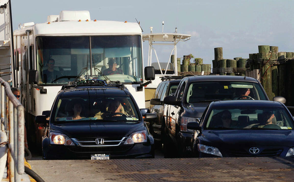 A ferry from from Ocracoke Island delivers passengers in Hatteras, N.C., Wednesday, Aug. 24, 2011. A visitor evacuation is underway on Ocracoke Island as Hurricane Irene approaches the Carolinas and the east coast. (AP Photo/Gerry Broome)