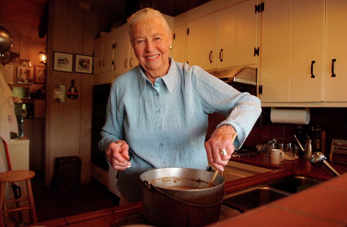 """FILE - This May 27, 2004 file photo shows Marion Cunningham, a venerated figure in the food world, at home in Walnut Creek, Calif. Cunningham, the home-cooking champion whose legacy can be found in the food-spattered pages of """"Fannie Farmer"""" cookbooks in kitchens across America, died of complications from Alzheimer's disease, a family friend told the San Francisco Chronicle. She was 90. (AP Photo/Ben Margot, file)"""