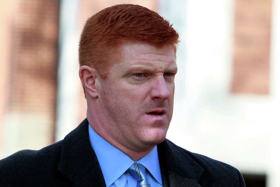 FILE - In this Jan. 25, 2012 file photo, former Penn State assistant football coach Mike McQueary arrives to the Pasquerilla Spiritual Center on the Penn State campus for the funeral service of former Penn State football coach Joe Paterno in State College, Pa. Former FBI director Louis Freeh, who led a Penn State-funded investigation into the university's handling of molestation allegations against former assistant football coach Jerry Sandusky, is scheduled to release his highly anticipated report Thursday, July 12, 2012. (AP Photo/Jacqueline Larma, File) / AP2012