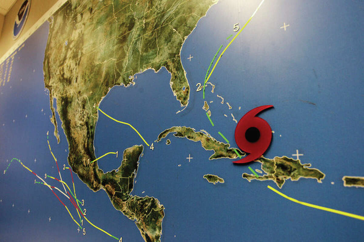 A red disc on a Miami's National Hurricane Center wall map shows the location of Hurricane Irene as it passes through the Bahamas Wednesday, Aug. 24, 2011. Hurricane Irene strengthened to a major Category 3 storm over the Bahamas on Wednesday with the East Coast in its sights. Irene's maximum sustained winds increased to near 115 mph (185 kph) with additional strengthening forecast, the U.S. National Hurricane Center in Miami said. (AP Photo/J Pat Carter)