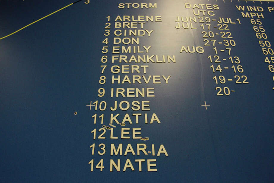 A list of hurricane names, including Irene, are displayed on a wall map at the National Hurricane Center in Miami Hurricane Center in Miami, Wednesday, Aug. 24, 2011. Irene strengthened to a major Category 3 storm over the Bahamas on Wednesday with the East Coast in its sights. Irene's maximum sustained winds increased to near 115 mph (185 kph) with additional strengthening forecast, the U.S. National Hurricane Center in Miami said. (AP Photo/J Pat Carter) / AP