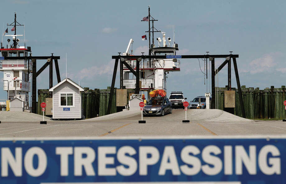 People from Ocracoke Island arrive at Cape Hatteras ferry terminal in preparation for Hurricane Irene in Cape Hatteras. N.C. on Wednesday, Aug. 24, 2011. Evacuations began on a tiny barrier island off North Carolina as Hurricane Irene strengthened to a major Category 3 storm over the Bahamas on Wednesday with the East Coast in its sights.(AP Photo/Jose Luis Magana) / FR159526 AP