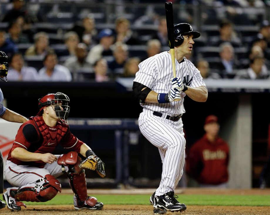New York Yankees designated hitter Travis Hafner watches his eighth-inning solo home run in a baseball game against the Arizona Diamondbacks at Yankee Stadium in New York, Wednesday, April 17, 2013. (AP Photo/Kathy Willens) / AP