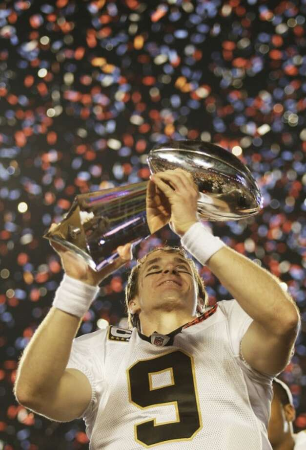 FILE - In thie Feb. 7, 2010 file photo New Orleans Saints quarterback Drew Brees (9) holds the Vince Lombardi Trophy after the NFL Super Bowl XLIV football game against the Indianapolis Colts in Miami. The Saints won 31-17. After years of scorn from their fans, the Saints finally became Super Bowl champions. (AP Photo/David J. Phillip)