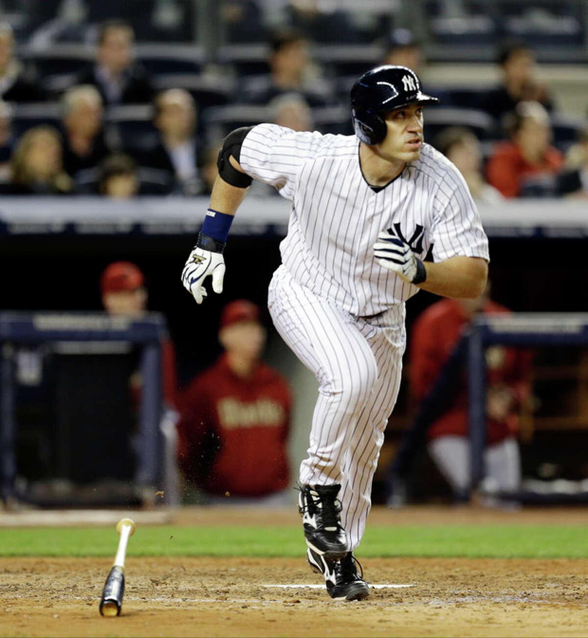 New York Yankees designated hitter Travis Hafner watches his eighth-inning, solo home run in a baseball game against the Arizona Diamondbacks at Yankee Stadium in New York, Wednesday, April 17, 2013. (AP Photo/Kathy Willens)