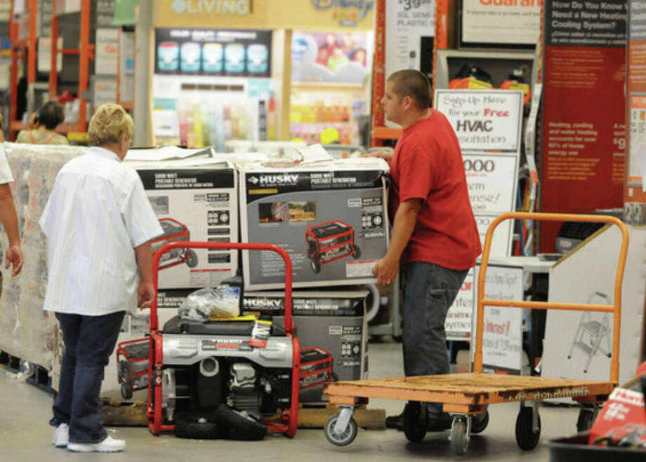 Customer Joe Outten selects a generator as area residents stock up on supplies at Home Depot in preparation for Hurricane Irene Wednesday Aug. 24, 2011 in Wilmington, N.C. Hurricane Irene strengthened to a major Category 3 storm over the Bahamas on Wednesday with the East Coast in its sights. (AP Photo/Star-News, Paul Stephen) NO SALES, NO MAGS, INTERNET OUT / 2011