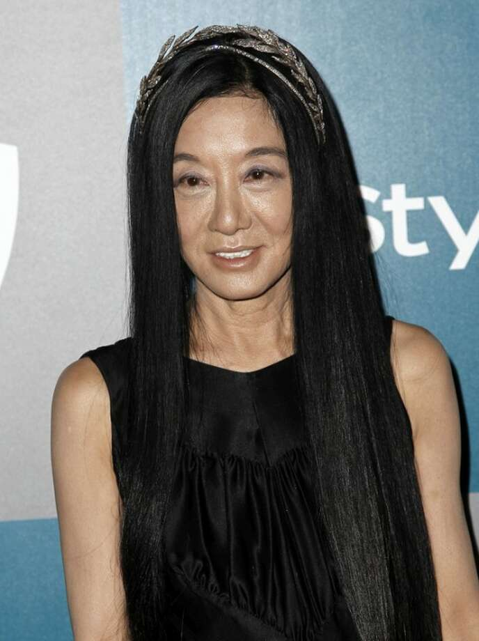 """FILE - This Jan. 15, 2012 file photo shows fashion designer Vera Wang at the 2012 Warner Bros. and InStyle Golden Globe After Party at the Beverly Hilton in Los Angeles. Wang, who launched her label with wedding gowns, is separating from her husband Arthur Becker. A statement was issued to Women's Wear Daily earlier this week from company president Mario Grauso that said Wang and Becker """"mutually and amicably agreed to separate."""" The couple married in 1989, when she still worked for Ralph Lauren. They have two daughters. (AP Photo/Matt Sayles, file)"""