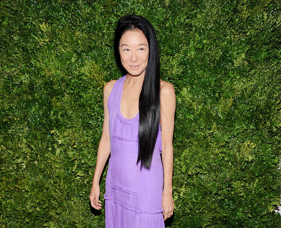 """FILE - This Nov. 14, 2011 file photo shows fashion designer Vera Wang attending the CFDA / Vogue Fashion Fund Awards in New York. Wang, who launched her label with wedding gowns, is separating from her husband Arthur Becker. A statement was issued to Women's Wear Daily earlier this week from company president Mario Grauso that said Wang and Becker """"mutually and amicably agreed to separate."""" The couple married in 1989, when she still worked for Ralph Lauren. They have two daughters. (AP Photo/Evan Agostini, file) / AP2011"""