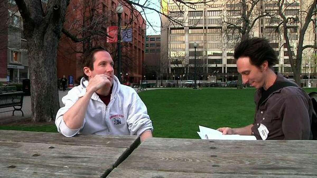 This image from video shows Boston Marathon bombing victim Kevin White (left) sitting with his brother, Andrew White, on Wednesday evening, April 17, 2013 soon after Kevin White was released from Boston Medical Center, where he was treated for injuries he suffered in Monday's blast. Kevin White had just left a restaurant with his parents when the first of two bombs that hit the Boston Marathon exploded about 10 feet away. The force of the blast, he said Wednesday, was so strong that it slammed them to the ground, breaking some of his mother's bones and tearing his father's right foot so badly surgeons had to amputate it. (AP Photo/Rodrique Ngow)